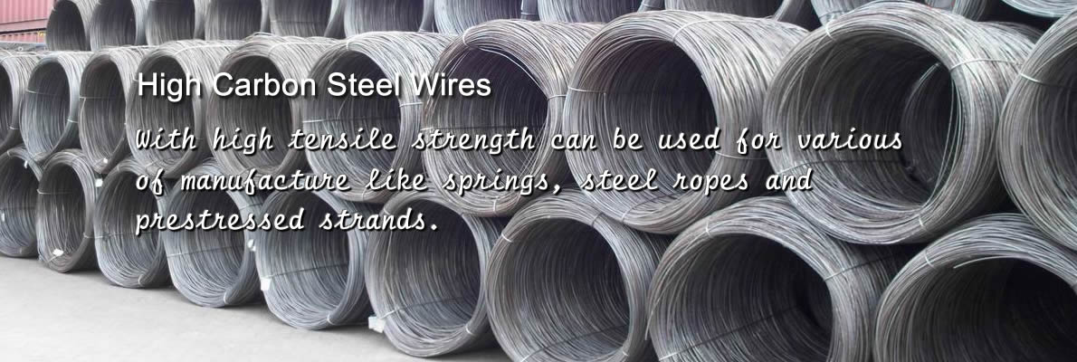 Quantities of high carbon steel wire coils with black surface are neatly arranged on the ground.